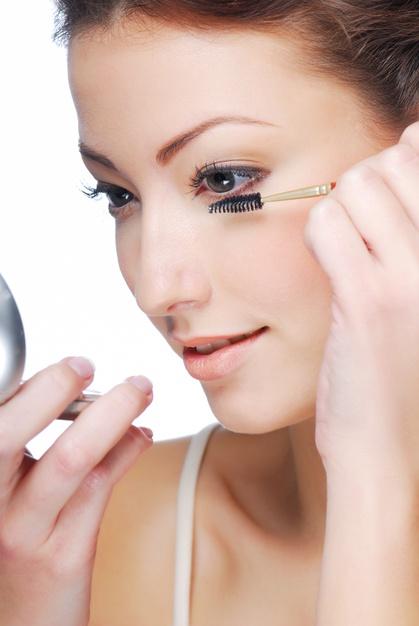 women applying eyelash serum